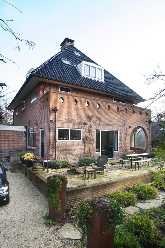 aanbouw in stijl villa, terras, baksteen